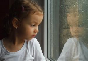 sad girl at window