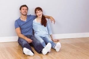 happy couple on floor